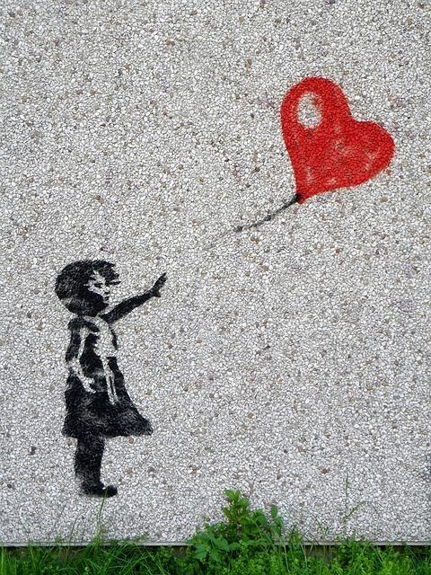 風船を手放す少女のグラフィックアート