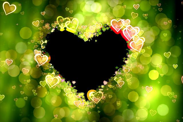 緑の背景に小さなハートが集まってハートの形をしている恋愛のハート