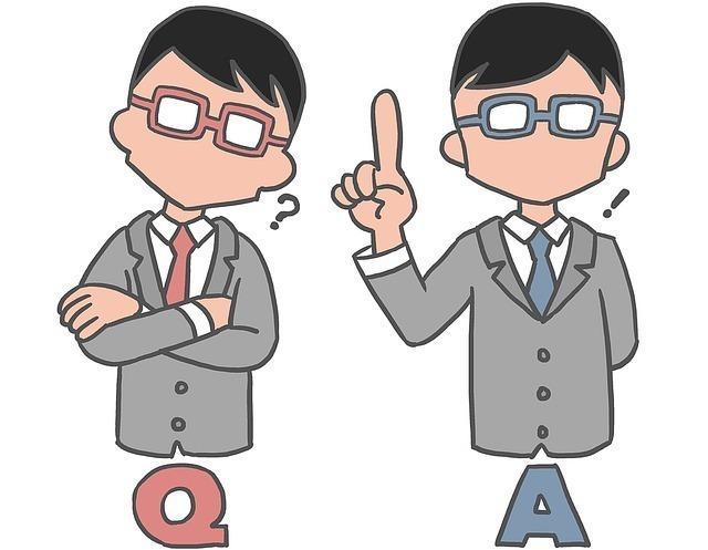 疑問をもっている赤いネクタイの男性と答えがひらめいた青いネクタイの男性