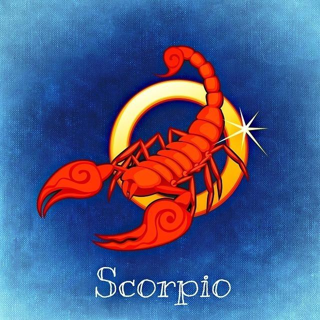 蠍座をイメージした赤い蠍と金の輪のイラスト画像