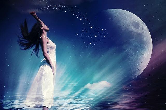 天空に星のきらめきを放つ女性